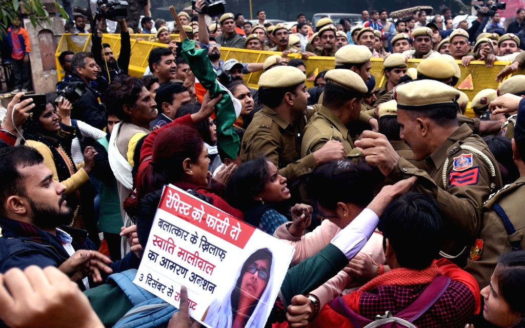 People stage a protest march to express support to Delhi Commission for Women (DCW) chief Swati Maliwal who is on an indefinite hunger strike demanding justice for rape victims, in New ...
