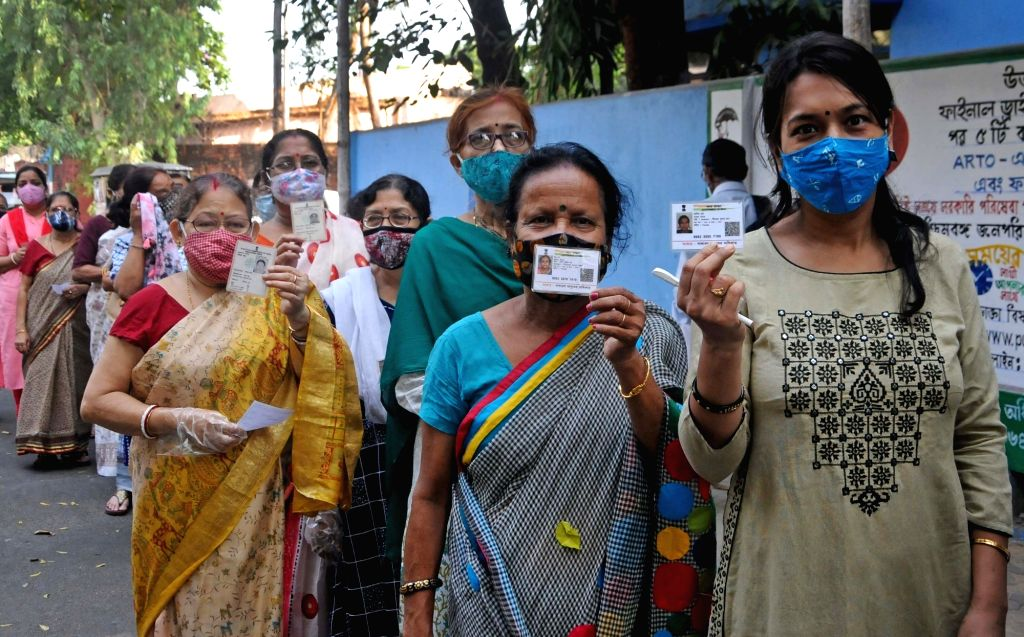 People stand in a queue at a polling station to cast their vote during the 5th phase of West Bengal's State Assembly elections in Kolkata on Saturday, 17th April, 2021.
