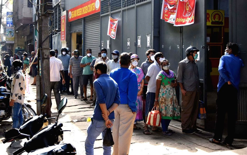 People standing in a queue to buy chicken at Chicken shop, during Coronavirus lockdown in the wake of the 2nd wave of COVID-19in Bengaluru on Friday 23 May 2021.