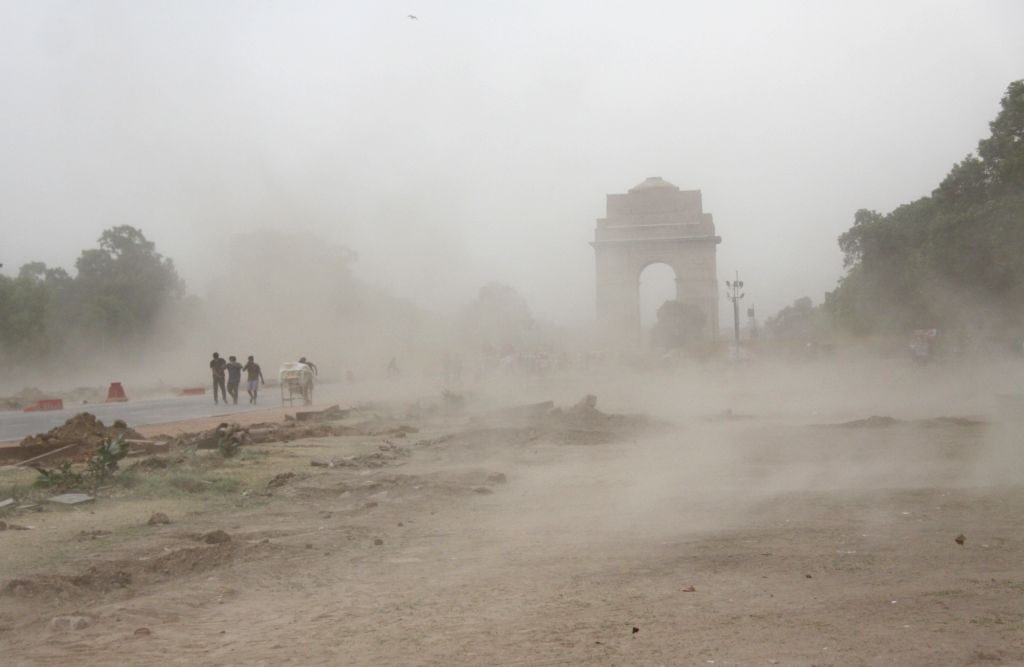 People stuck during the heavy Storm at India gate in new Delhi On Friday, 16th April,2021.