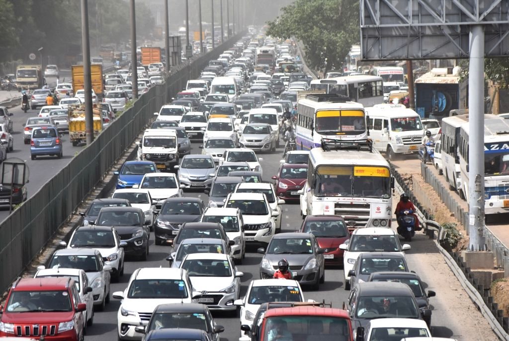 People stuck in a traffic jams because of a large four feet hole which appears on the Hero Honda Chowk flyover on the Delhi-Jaipur stretch of the National Highway 8, in Gurugram, on May 8, ...
