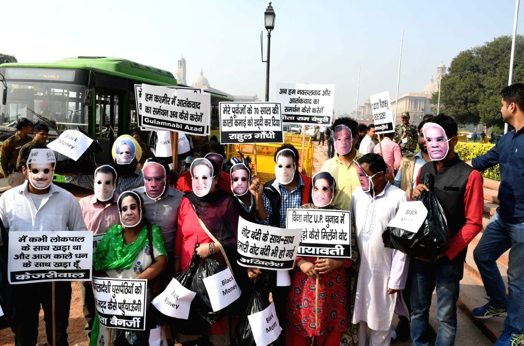 People supporting central government's demonetisation move stage a demonstration at Vijay Chowk in New Delhi on Nov 24, 2016.