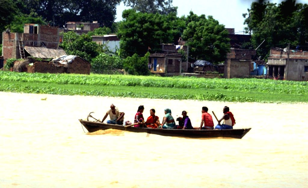 People take a boat ride in floodwaters at Maner Block about 40 kms outskirt in Patna district of Bihar, on Sept 7, 2018. (Photo: IANS)