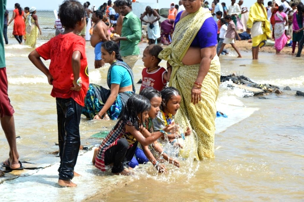 People take a dip in River Krishna during Krishna Pushkaralu river festival at Alampur mandal of Mahabubnagar district, Telangana on Aug 19, 2016.