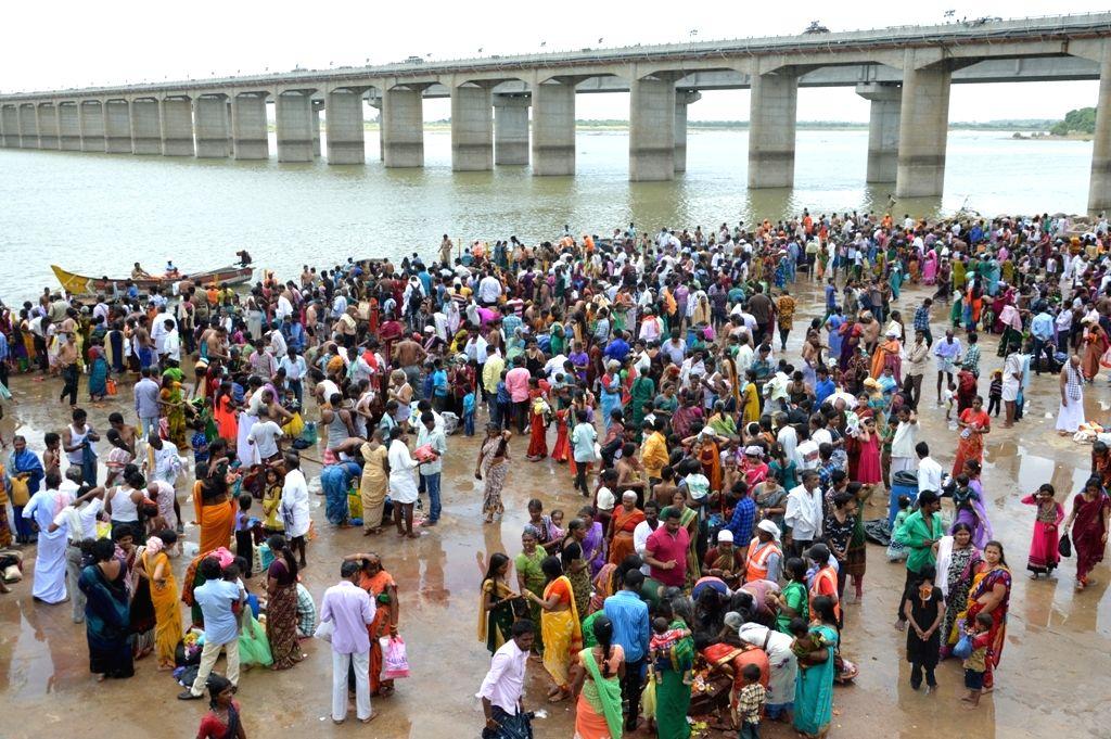 People take a dip in River Krishna during Krishna Pushkaralu river festival at Alampur mandal of Mahabubnagar district, Telangana on Aug 20, 2016.