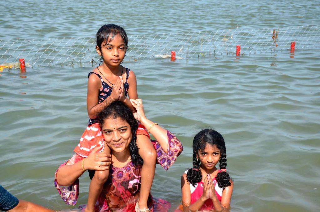 People take a dip in River Krishna on the occasion of Krishna Pushkaralu in Nalgonda district of Telangana on Aug 12, 2016.