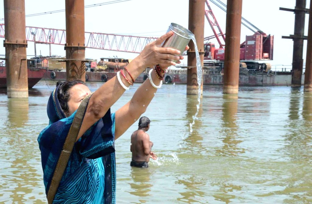 People take a holy dip in the Ganga river on the occasion of Buddha Purnima in Patna during the extended nationwide lockdown imposed to mitigate the spread of coronavirus, on May 7, 2020.