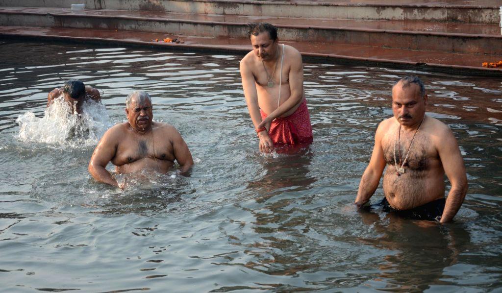People take dip in the Gomti River on Makar Sankranti in Lucknow on Jan 14, 2016.