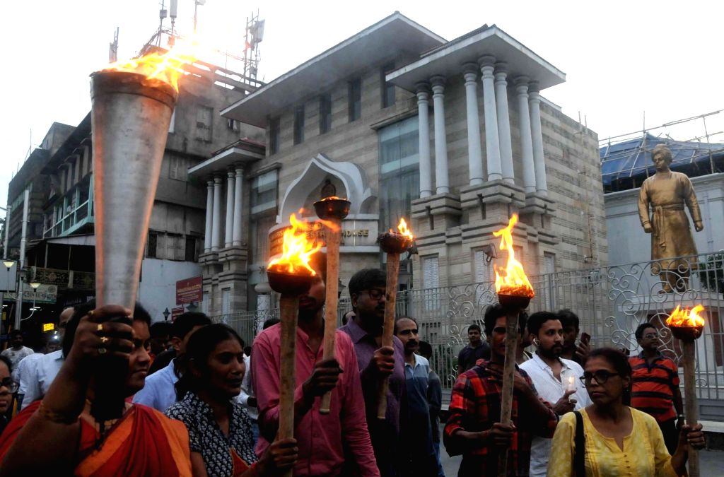 People take out a torch rally against political violence and disrupted health services in West Bengal, from Swami Vivekananda's Ancestral House and Cultural Centre in Kolkata on June 15, ...
