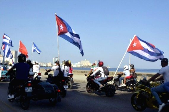 People take part in a caravan in Havana, Cuba, on March 28, 2021. (Photo by Joaquin Hernandez/Xinhua/IANS)