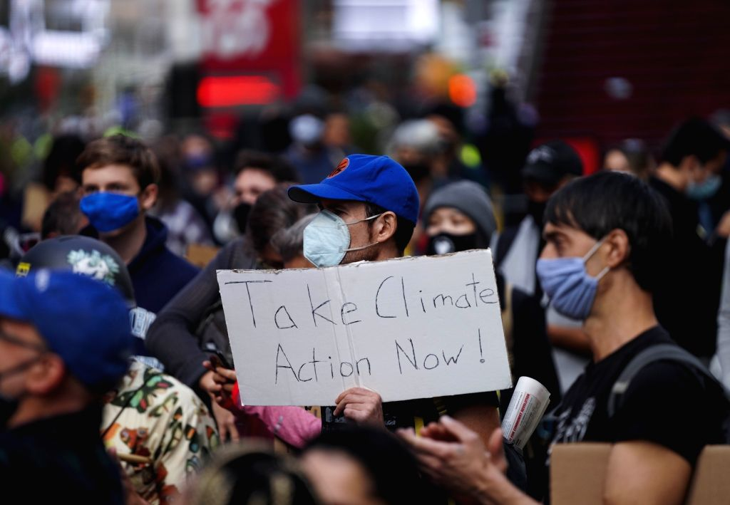 People take part in a climate change protest in Times Square in New York, the United States, on Sept. 20, 2020.