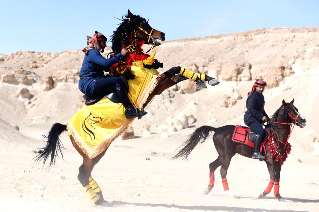 People take part in a horse riding show in Jahra Governorate, Kuwait, Jan. 25, 2020.
