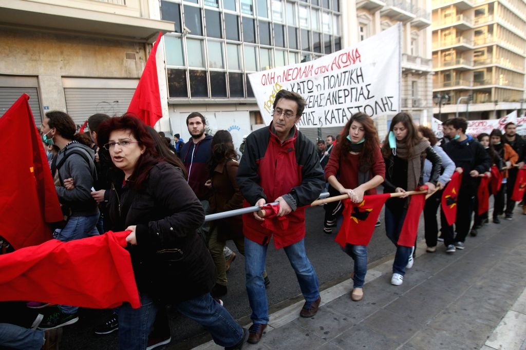 People take part in a rally to commemorate the death of a 15-year old student seven years ago, in Athens, Dec. 6, 2015. Hundreds of protesters took to the streets of ...