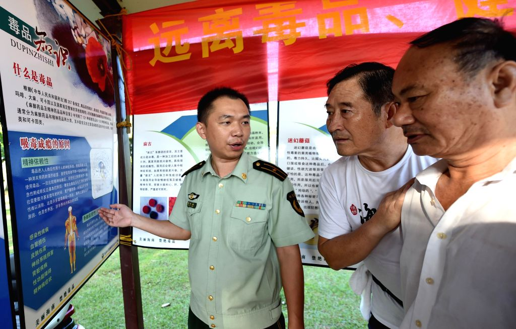 People take part in an anti-drug activity on the International Day Against Drug Abuse and Illicit Trafficking in Haikou, capital of south China's Hainan Province, ...