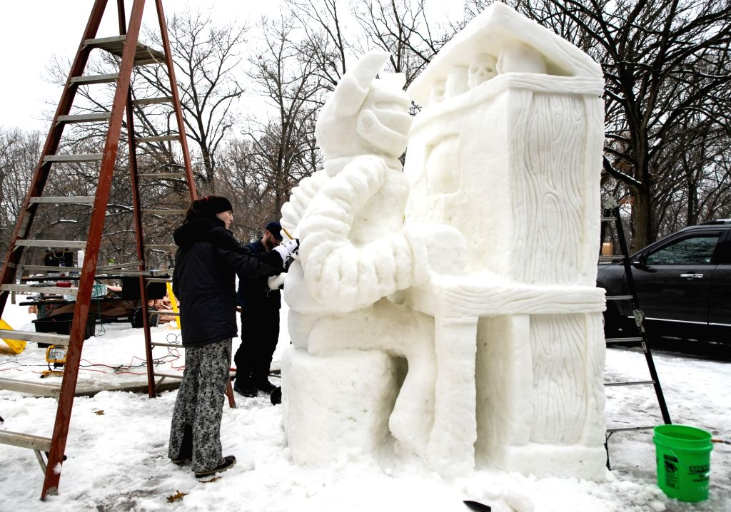 People take part in the Illinois Snow Sculpting Competition in Rockford, Illinois, the United States, on Jan. 24, 2020.