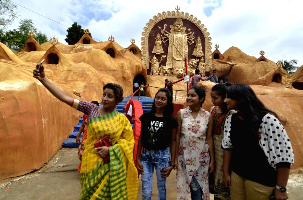People take selfie at a Durga Puja Pandal in Guwahati on Oct 10, 2016.