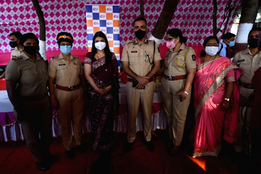 - People taking  selfie during Woman police celebration in Mumbai on Friday March 05, 2021
