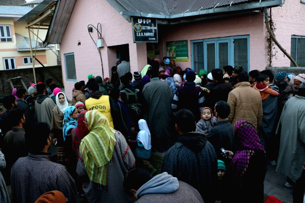 People throng a medical centre in Pulwama of Kashmir after rumours regarding deaths of children following polio vaccination spread, on Jan 17, 2016. Authorities appealed for calm after the ...