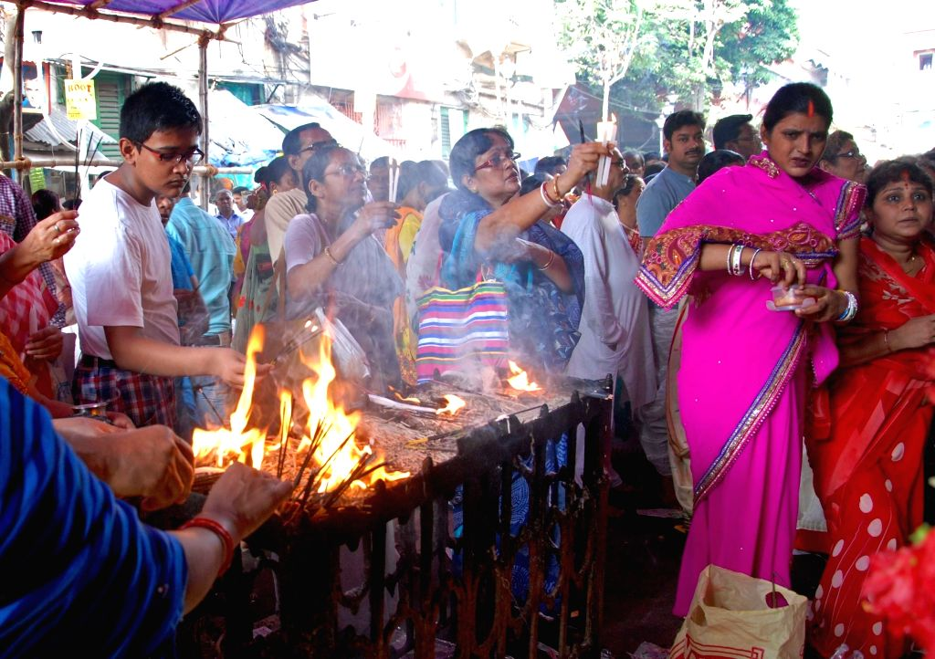 People throng a temple on ``Poila Baisakh`` -Bengali New Year 1423- in Kolkata, on April 14, 2016.