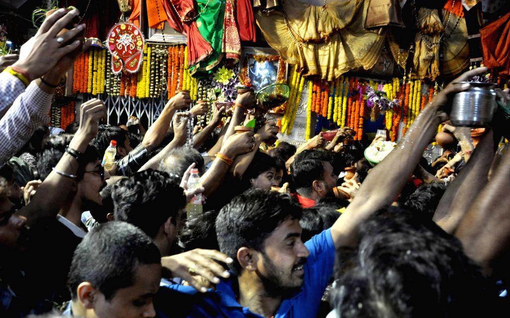 People throng Baba Bhutnath Temple on Maha Shivratri in Kolkata, on March 4, 2019.