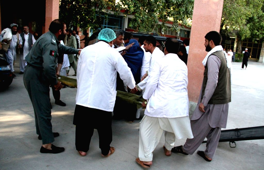 People transfer an injured child to a hospital after an earthquake in Jalalabad, capital of eastern Nangarhar province, Afghanistan, Oct. 26, 2015. Preliminary ...