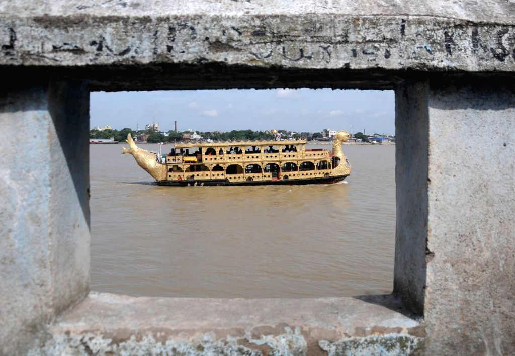 People travel in a ship through the waters of the Ganga river on the occasion of Mahalaya, in Kolkata on Sep 17, 2020.