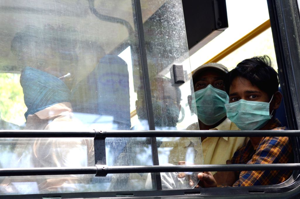 People travelling in a bus wear masks as a precautionary measure against COVID-19 (coronavirus) in Bengaluru on March 18, 2020.
