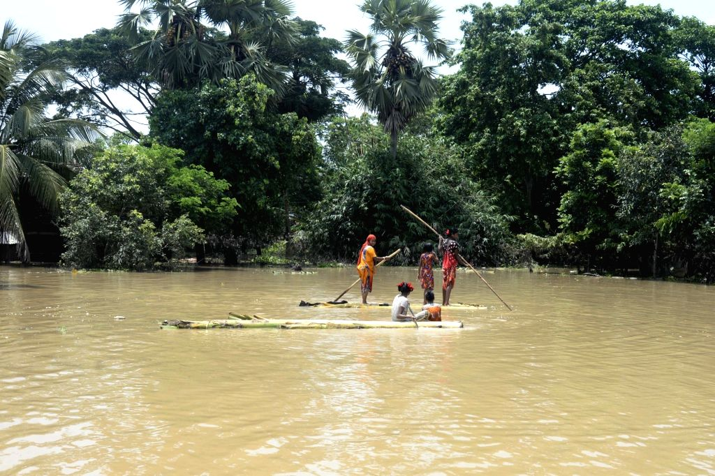 People use boats to commute in flood hit Amta of West Bengal on Aug 2, 2017.