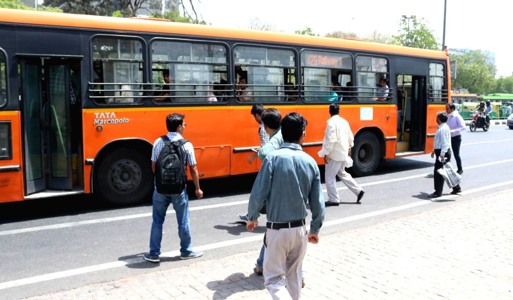 People use public transport to commute on the fourth day of implementation of odd-even traffic scheme aimed at battling pollution in New Delhi on April 18, 2016.