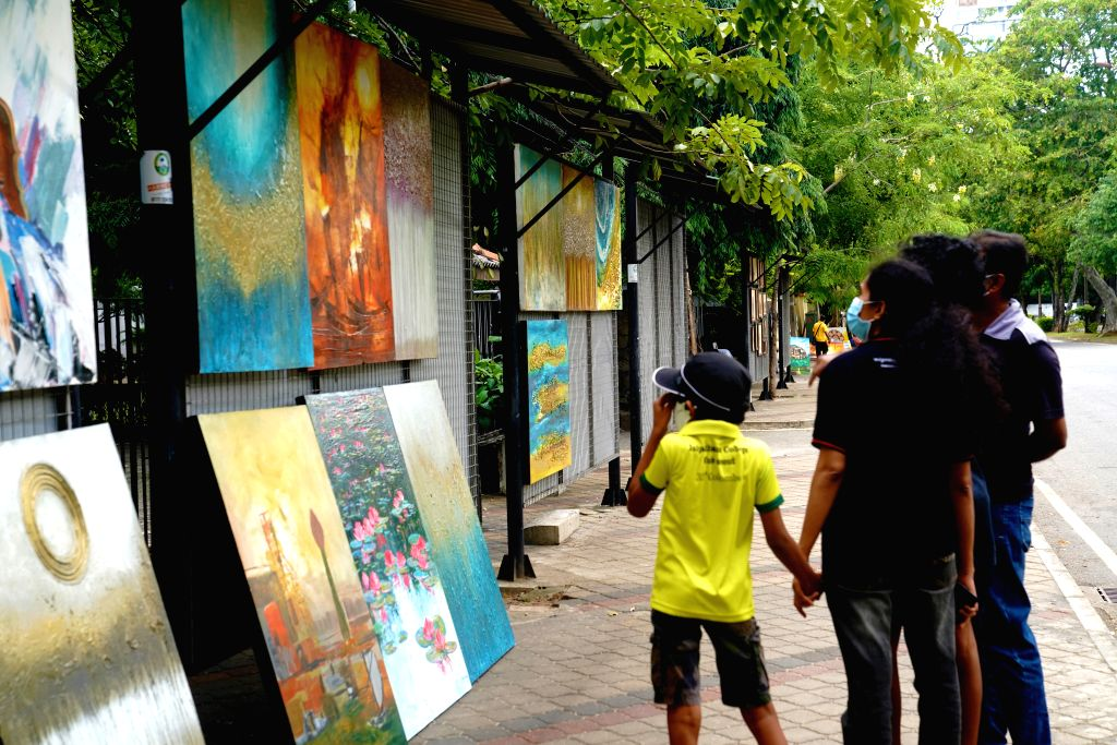 People view paintings at Green Path, a hub of open-air art shows, in Colombo, capital of Sri Lanka, on July 4, 2020. Open-air art shows at Green Path disappeared ...