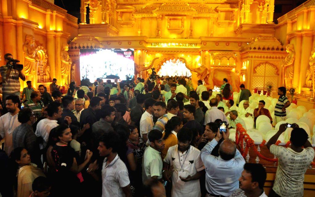 People visit a Durga Puja Pandal in Kolkata on Sept 18, 2017.