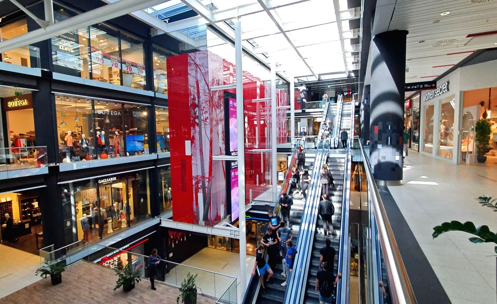 People visit a reopened shopping mall in Belgrade, Serbia, on May 8, 2020. The Serbian National Assembly adopted government proposal to abolish the state of ...
