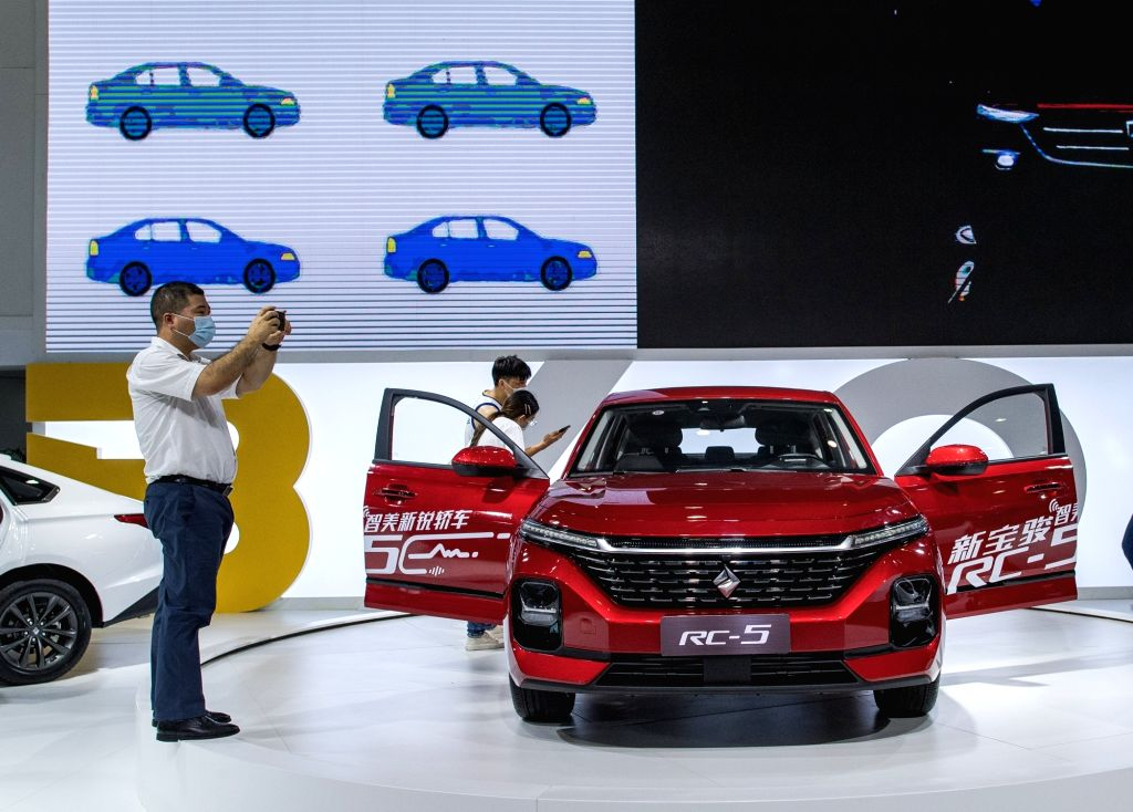 People visit an auto show in Wuhan, capital of central China's Hubei Province, Aug. 13, 2020. More than 60 brands took part in the 18th Central China International ...