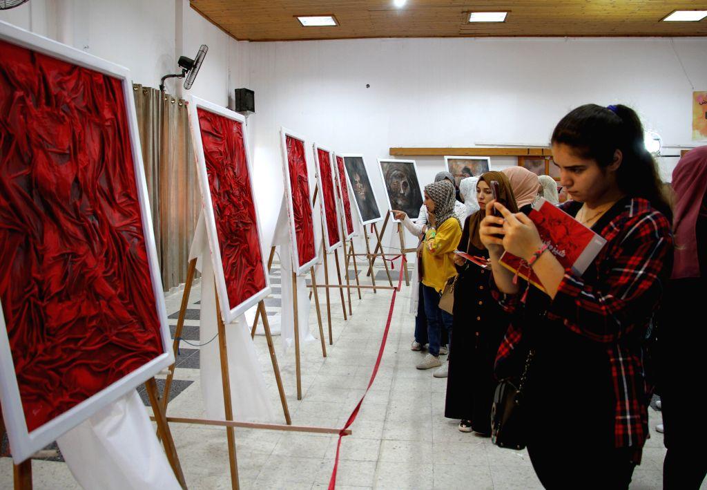 People visit an exhibition of Palestinian artist Kholoud al-Dasooqi in Gaza City, on Aug. 11, 2020. Kholoud al-Dasooqi, a Palestinian artist from the Gaza Strip city ... - Kholoud