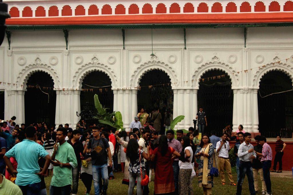 People visit Shobhabazar Rajbari during Durga Puja in Kolkata, on Oct 9, 2016.