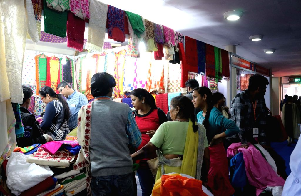 People visit stalls at the India International Trade Fair ( IITF) held in New Delhi on Nov. 19, 2016.