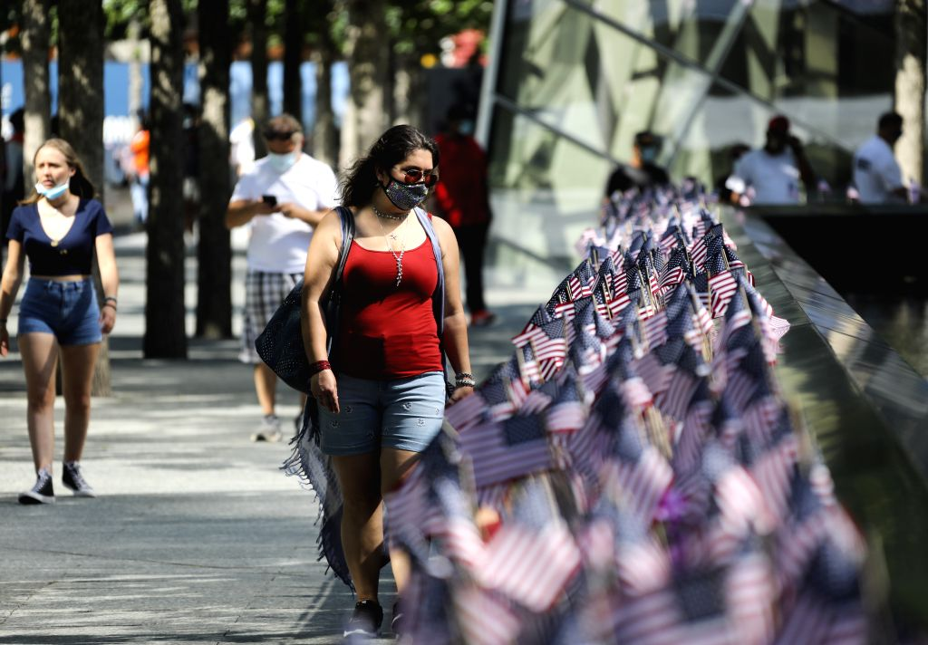 People visit the reopened National September 11 Memorial and Museum in New York, the United States, July 4, 2020. The number of COVID-19 cases in the United States ...