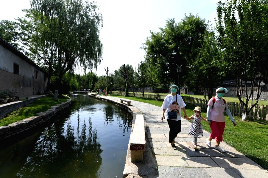 People visit the Sanlihe park in Dongcheng District of Beijing, capital of China, June 7, 2020.