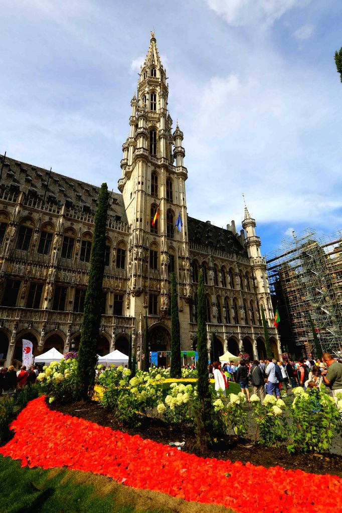 People visit the Second Flowertime Exhibition at the City Hall in Brussels, Belgium, on Aug. 16, 2015. The four-day event with an Italian baroque theme was opened ...