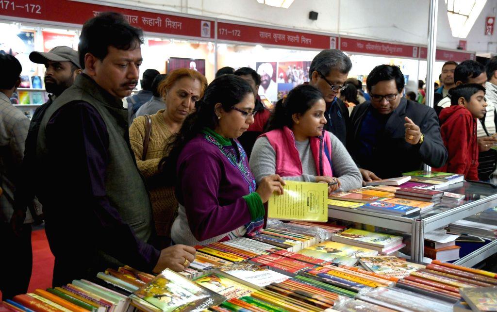 People visit World Book Fair being held at Pragati Maidan in New Delhi, on Jan 14, 2017.