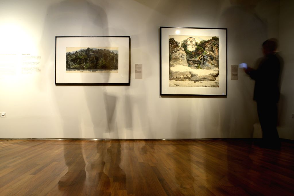 People visit Wu Guanzhong's painting exhibition at the National Gallery Singapore, Nov. 25, 2015. The exhibition kicked off here on Wednesday. (Xinhua/Then Chih ...