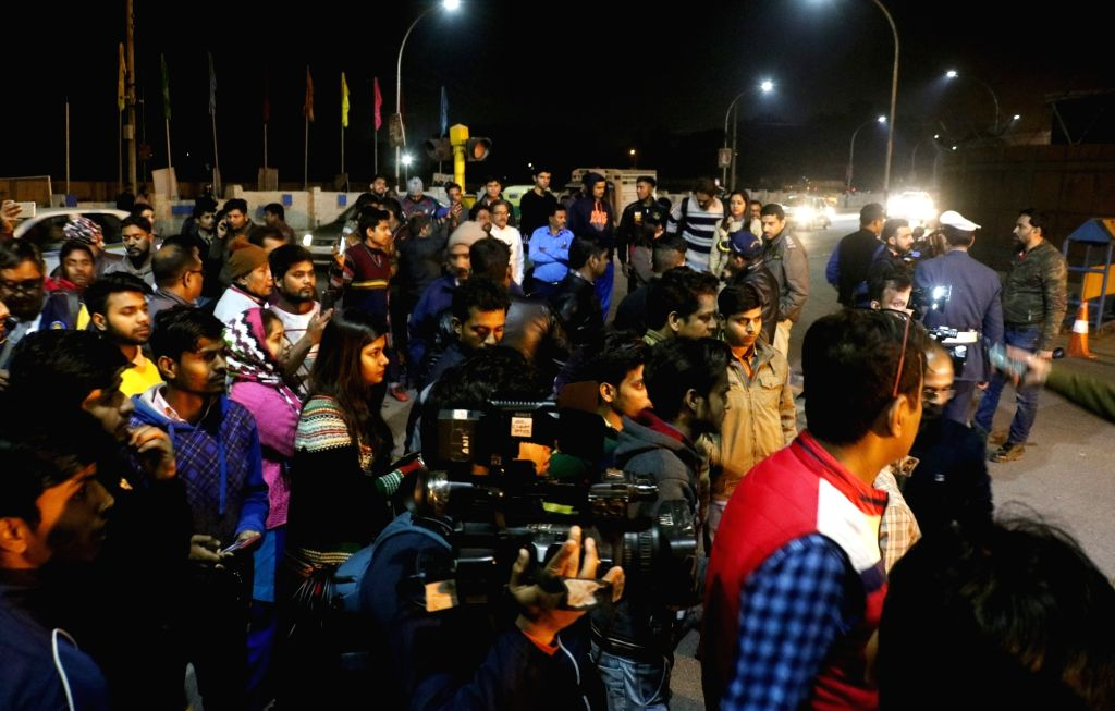 People wait for arrival of 35-year-old IAF Wing Commander Abhinandan Varthaman who returned back to India; in New Delhi on March 1, 2019. He was captured on Wednesday by Pakistan after his ...