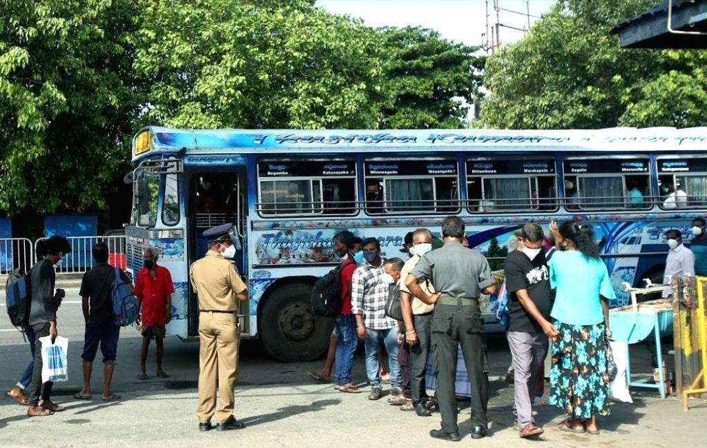 People wait for buses in Colombo, Sri Lanka, on June 21, 2021.