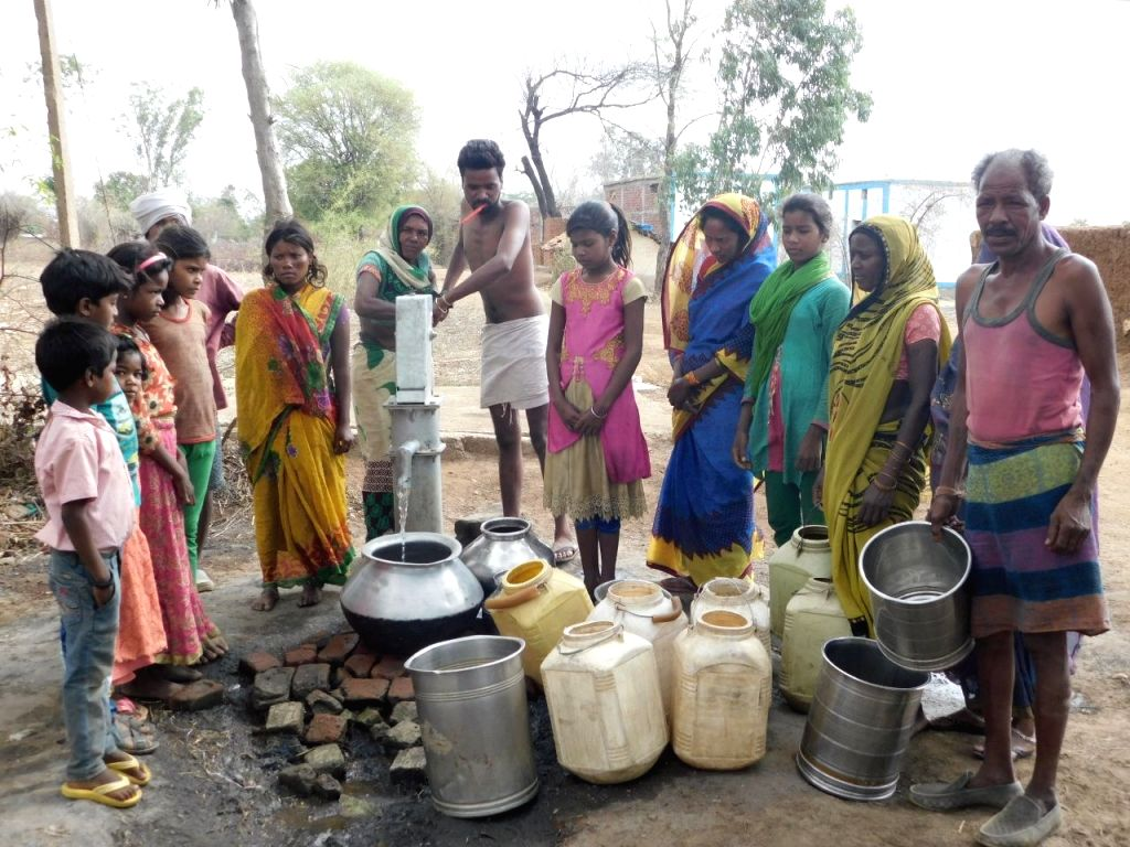 People wait for their turn to collect water in Madhya Pradesh's Shahdol on May 11, 2019.