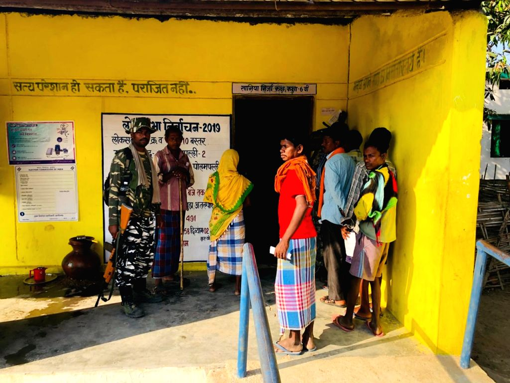 People wait in a queue to cast their votes for the first phase of 2019 Lok Sabha elections, at a polling booth in Chhattisgarh's Bastar, on April 11, 2019.