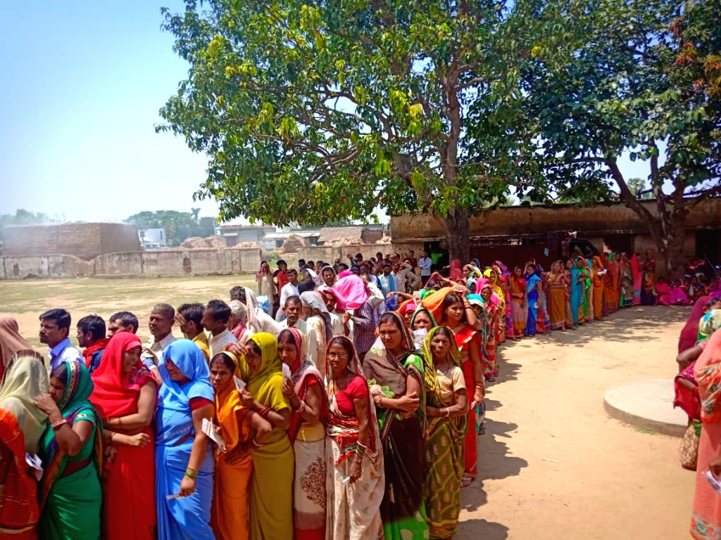 People wait in multiple queues to cast their votes for the second phase of 2019 Lok Sabha elections in Bihar's Banka, on April 18, 2019.