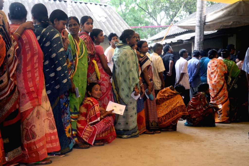 People wait in queue during the sixth phase of 2019 Lok Sabha polls, in West Bengal's Midnapore, on May 12, 2019.