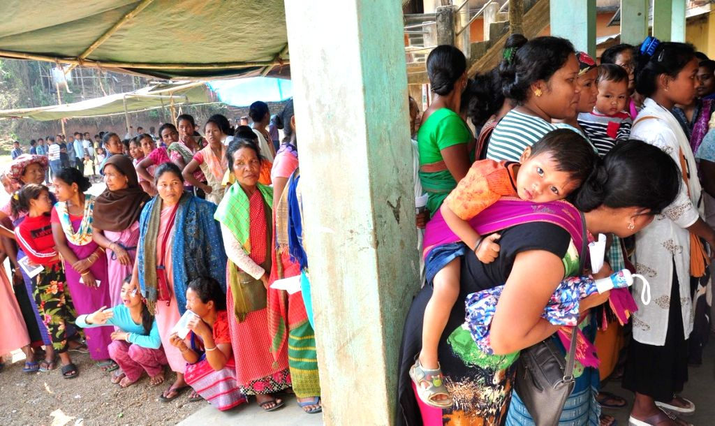 People wait in queues to cast their votes for the first phase of 2019 Lok Sabha elections, at a polling station in Meghalaya's Ri-Bhoi district, on April 11, 2019.