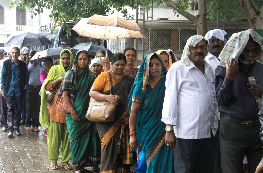 People wait in queues to pay tribute to the mortal remains of senior Kannada journalist and social activist Gauri Lankesh in Bengaluru on Sept 6, 2017. Editor of the weekly Kannada ...