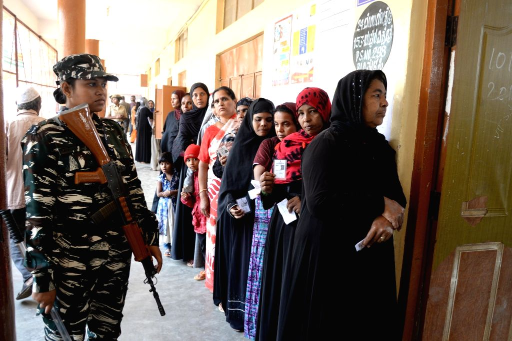 People wait in the queue at Yeshwantha Pura constituency  to cast their vote for the Karnataka Assembly Bye election, in Bengaluru on Dec. 5,  2019.